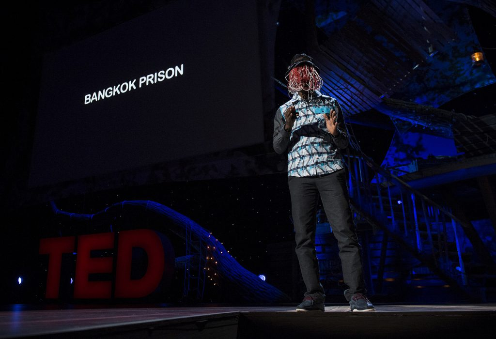 Anas Aremeyaw Anas explaining his work to an international audience at TED 2013, Long Beach, California, USA. With anonymity guaranteeing his seeming invisibility, the investigative journalist unearths institutional corruption as a way to pressure the state to clean up governance in Africa │© James Duncan Davidson