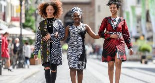 African fashion seduces Europe! Rama Diaw (middle) and her models present her collections in the old city of Würzburg during the 2016 Africa Festival. The Senegalese designer sold 2,500 dresses at the biggest festival of African music and culture in Europe / © Bugs Steffen