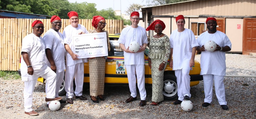 Alex Holmes, MoneyGram Global CEO (4th from right), and the Lagos MoneyGram management team supporting the MoneyGram Foundation charitable activities in Lagos, 2016. During a visit to Frankfurt recently to open the new office of his company, Holmes reiterated that Nigeria and Africa were very important to MoneyGram / © MoneyGram Foundation