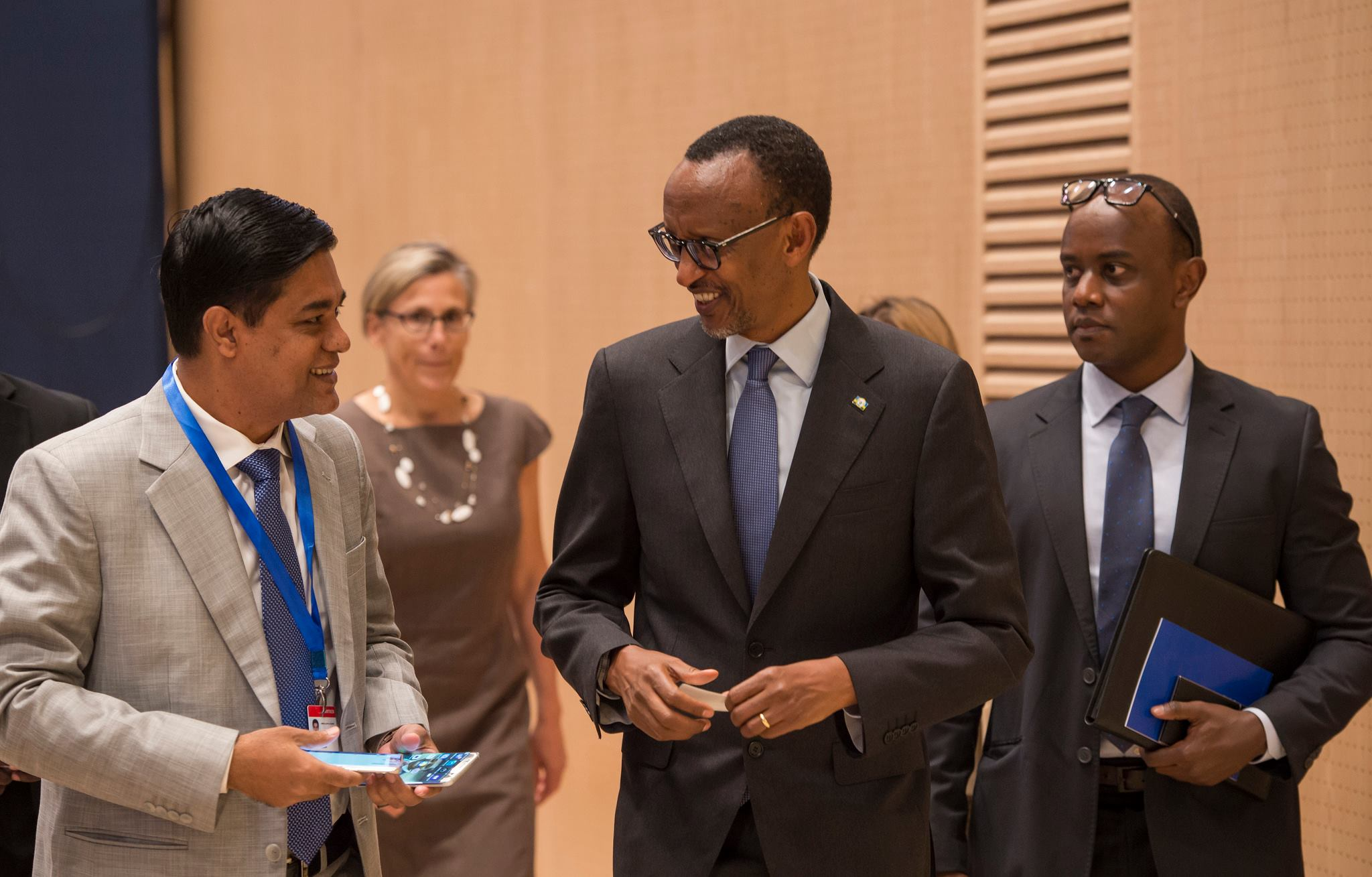 President Paul Kagame (right) with some delegates at the historic conference / © PK