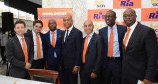 Six of Ria's management team travelled to Ghana to take part in the launch event. From left to right: Ignacio Reid, Adolfo Galvez, Emmanuel Bampoe, GCB's MD, Simon Dornoo (centre), Rogelio Lopez, Malick Seck and Robert Kotei │© Ria Money Transfer