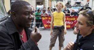 Mbolo Yufanyi Movuh (left) participating at a protest action for refugees in Berlin, 2012