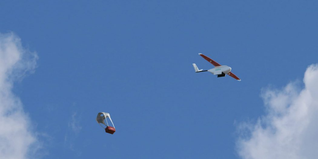 When the drone reaches its destination, its payload is released over a predetermined area and is parachuted down to the ground / © Zipline